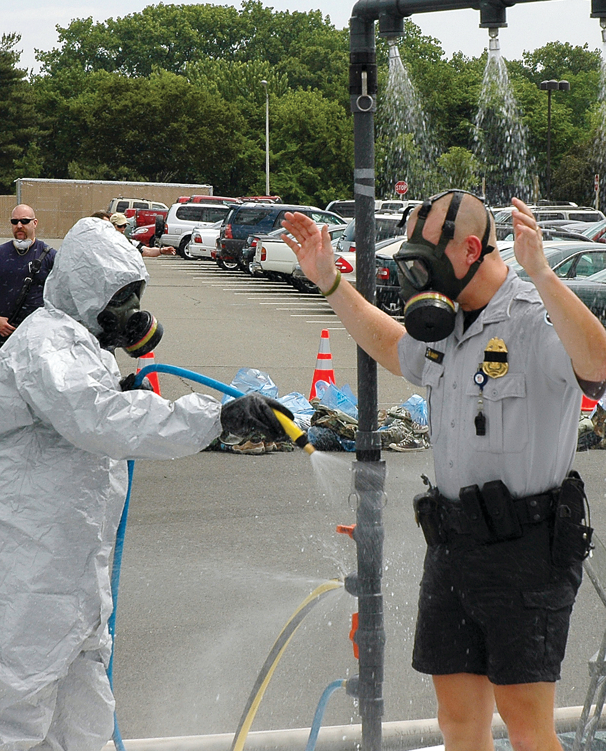 A member of the Pentagon Force Protection Agency is decontaminated during an exercise at the Pentagon on Wednesday, May 17, 2006. During Exercise Gallant Fox 06, officials from Washington, D.C., area fire, emergency medical service, and police departments; military members; and members of the Pentagon Force Protection Agency participated in the exercise, which included decontamination and medical processing of victims of a simulated anthrax attack at the Pentagon. U.S. Air Force photo/Staff Sgt. C. Todd Lopez