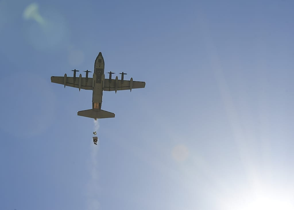 A U.S. Air Force HC-130J Combat King II performs heavy equipment parachute drops during Razor's Edge, a two-week long pre-deployment exercise, at Parker, Ariz., April 12, 2019. (U.S. Air Force photo by Airman 1st Class Kristine Legate)