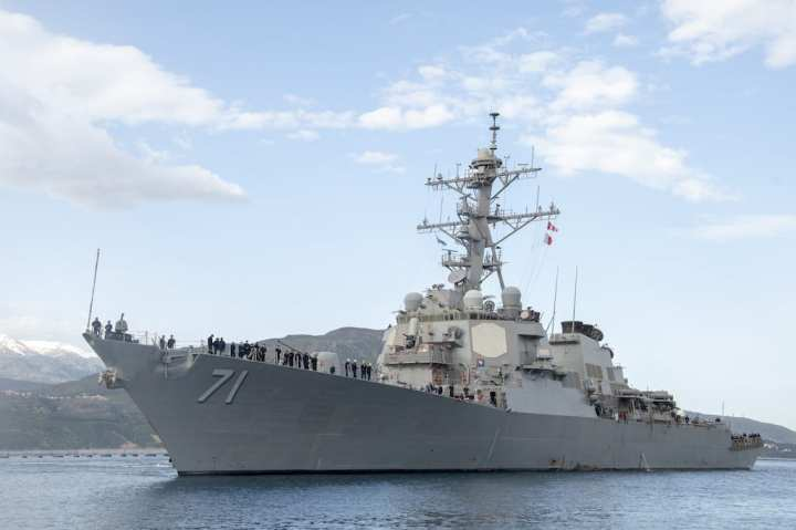 The Arleigh Burke-class guided-missile destroyer USS Ross (DDG 71) arrives at Souda Bay, Greece, for a scheduled port visit, April 12, 2019. Naval Support Activity Souda Bay is an operational ashore base that enables U.S., allied, and partner nation forces to be where they are needed and when they are needed to ensure security and stability in Europe, Africa, and Southwest Asia. (U.S. Navy photo by Mass Communication Specialist 2nd Class Kelly M. Agee/Released)