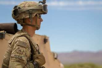 Sgt. Weston Patton, a cannon crewmember and chief assigned with Battery A, 4th Battalion, 27th Field Artillery Regiment, 2nd Armored Brigade Combat Team, 1st Armored Division, scans the horizon to keep sight of potential obstacles, such as wildlife and obtrusive terrain features while participating in Table XVIII gunnery qualification at Dona Ana Range Complex, New Mexico, May 7. Leaders such as Sgt. Patton use their wealth of experience to teach field artillery and warrior skills to their junior Soldiers to ensure combat readiness and deployability of the 4-27 FA.