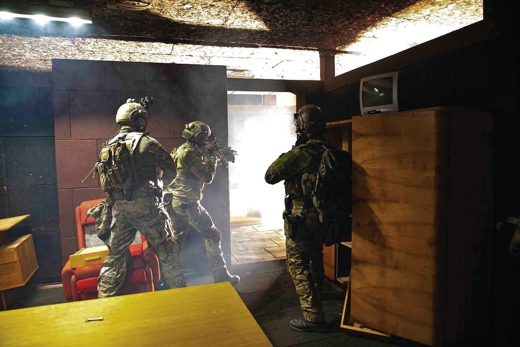 Polish and Slovakian special operations forces enter and clear a building after using a flash grenade Nov. 14, 2018 in Slovakia as part of the Advanced Combat Leaders Course
