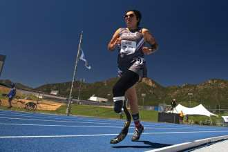 Team SOCOM Staff Sgt. Lauren Montoya runs a race during the 2018 Warrior Games at the Air Force Academy in Colorado Springs, Colo. June 2, 2018