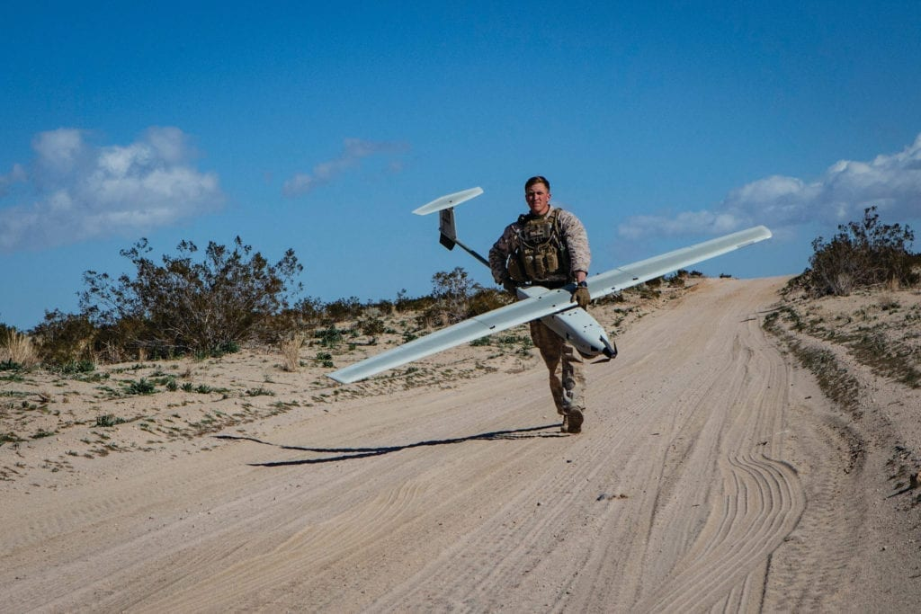 U.S. Marine Cpl. Jacob V. Tyler with Marine Air-Ground Task Force-6 (MAGTF-6), carries a Lockheed Martin Stalker Unmanned Ariel System (UAS) during Integrated Training Exercise (ITX) 2-19 aboard Marine Corps Air-Ground Combat Center Twentynine Palms, Calif., Feb. 9, 2019. ITX creates a challenging, realistic training environment that produces combat-ready forces capable of operating as an integrated MAGTF. (U.S. Marine Corps photo by Pfc. Skylar M. Harris)
