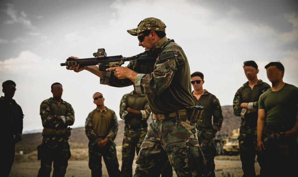 A Marine with 1st Marine Raider Support Battalion gives an instructional course on advanced weapons training, during Training Readiness Exercise II, at an undisclosed training site in Hawthorne, NV, Aug. 1, 2018. The purpose of this training was to create a realistic simulation of multiple operating environments while challenging the team with a hybrid threat
