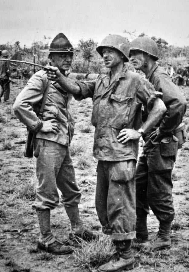 Colonel Charles Hunter, commanding officer of the 5307th, points a stick to orient General Stilwell, who has just flown into Myitkyina airfield the day it was taken, 17 May 1944