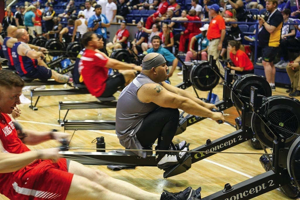 Chief Petty Officer Philip Fong rows during the indoor rowing competition of the Warrior Games at the U.S. Air Force Academy in Colorado Springs, Colorado on June 9, 2018. The Warrior Games enhance the recovery and rehabilitation of wounded, ill, and injured service members through adaptive sports