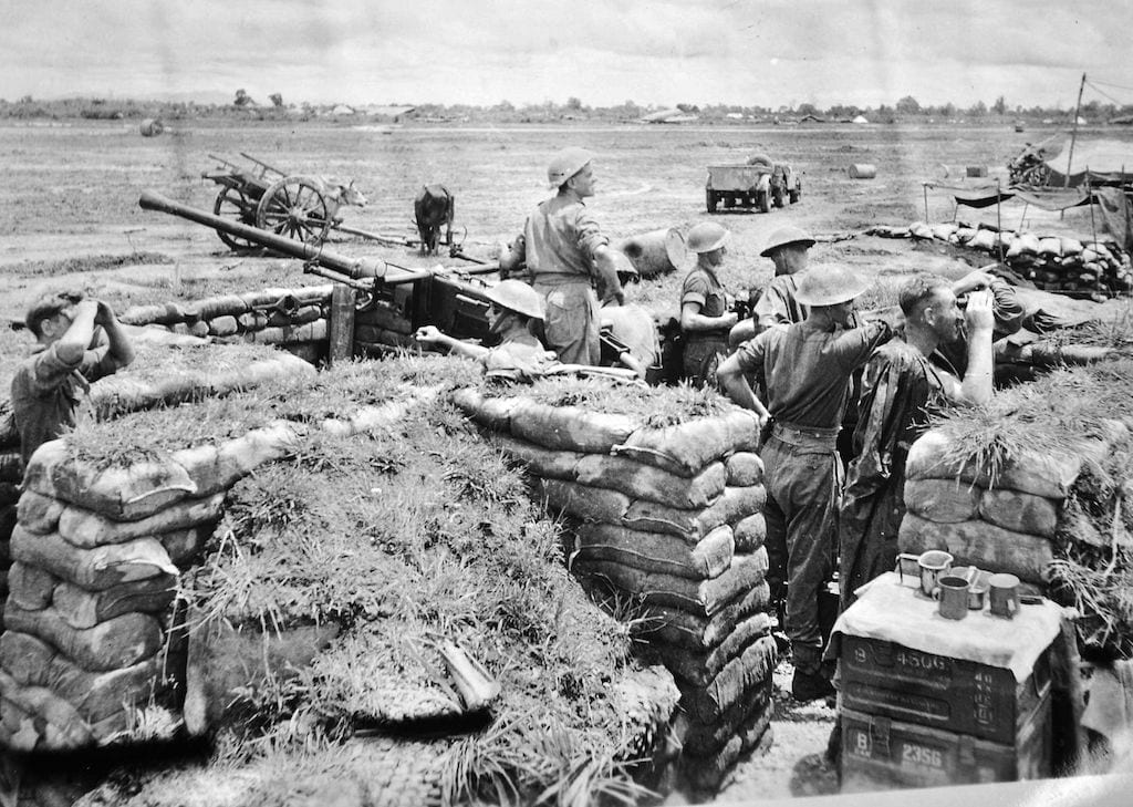 Bofors gun crew of the Royal Artillery on alert at Myitkyina airfield. These gunners had to fight as infantry alongside the 5307th