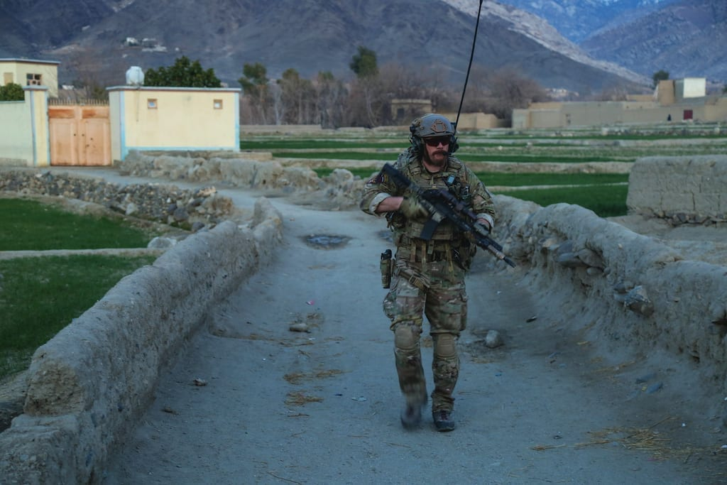 A U.S. Army Special Forces soldier, attached to Special Operations Task Force-Afghanistan, provides rear security for an Afghan Commando assault force after conducting a raid on a compound of interest during an operation in the Alingar District, Laghman province, Afghanistan, Feb. 18, 2018. Spin-offs from TALOS have included new tactical armor designs