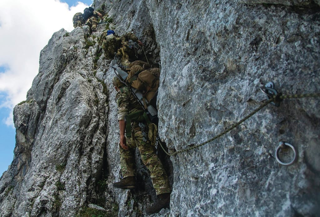 U.S. Army special operations forces assigned to 10th Special Forces Group (Airborne) climb a cliff face while conducting mountain warfare training in Mittenwald, Germany, July 18, 2018. Mountain warfare training is designed to improve movement over challenging terrain in many operational environments