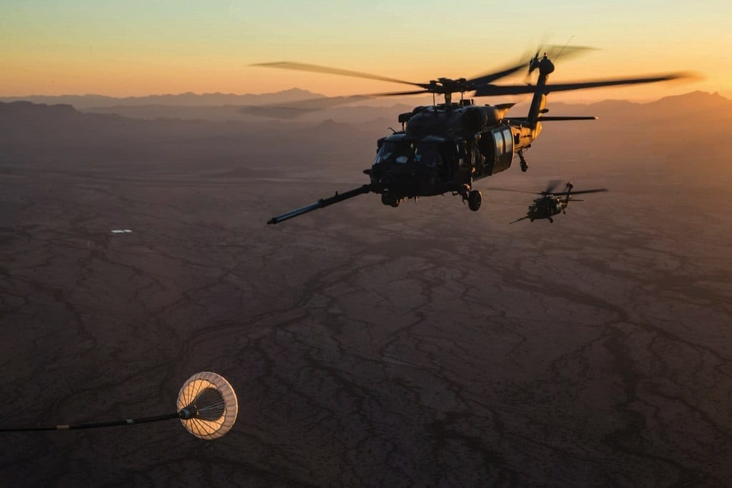 A pair of U.S. Army 160th Special Operations Aviation Regiment MH-60M Black Hawks prepare to conduct an aerial refueling exercise in support of Weapons and Tactics Instructor course (WTI) 1-18 in Yuma, Arizona