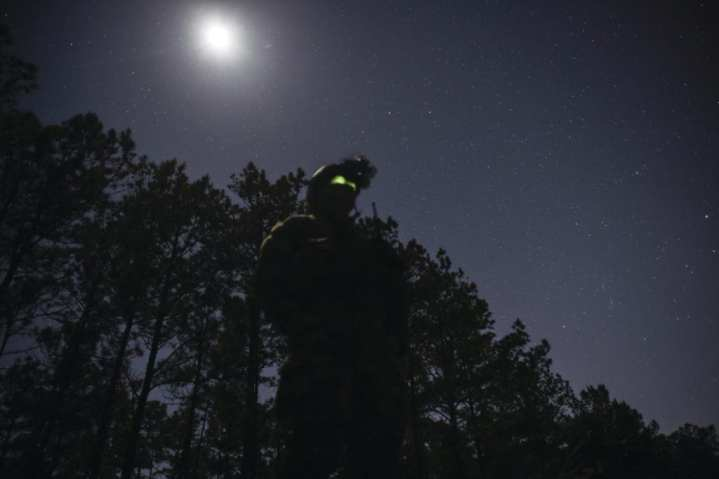 A Marine Special Operations School student maintains security during Field Training Exercise Raider Spirit at Camp Lejeune, North Carolina