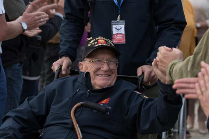 Gilbert D. Nadeau, a World War II veteran who served in the U.S. Navy, attends a memorial ceremony for the 1st Infantry Division Soldiers who died on D-Day.U.S. Army photo taken by Spc. Nicholas Vidro, 7th Mobile Public Affairs Detachment.
