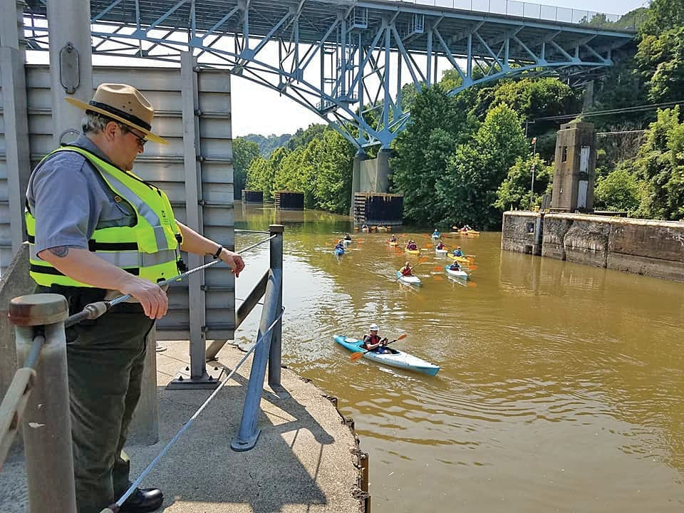 Park Ranger, Julie Stone serves as a part of the newly formed pilot program, River Rangers and watches paddlers approach Lock and Dam 2 on the Allegheny River. Stone and the river rangers promote and enforce water safety policies, which helps to ensure river users, pass through the district's navigation facilities safely.