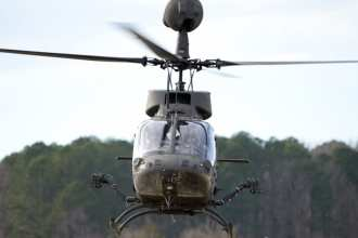 A Bell OH-58D Kiowa Warrior aircraft flies during a flight test performed by the U.S. Army Combat Capabilities Development Command Aviation & Missile Center's Aviation Development Directorate-Eustis at Joint Base Langley-Eustis, Virginia, Jan. 28