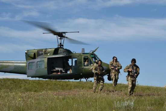 Airmen disembark a Minot Air Force Base Bell UH-1 Iroquois, during the advanced tactical course at Camp Guernsey, Wyo., June 19, 2019. The training involved UH-1s from F.E. Warren Air Force Base and Minot AFB for infiltration and exfiltration exercises. (U.S. Air Force photo by Staff Sgt. Ashley N. Sokolov)