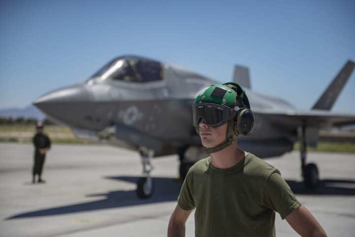 Lance Corporal Luke Toal, Fixed Wing Marine Fighter Attack Squadron 122 F-35B Lightning II fighter jet airframer, prepares to marshal his aircraft before launch at Nellis Air Force Base, Nev., July 16, 2019. VMFA-122 is based out of Marine Corps Air Station Yuma, Arizona. (U.S. Air Force photo by Senior Airman Julian W. Kemper)