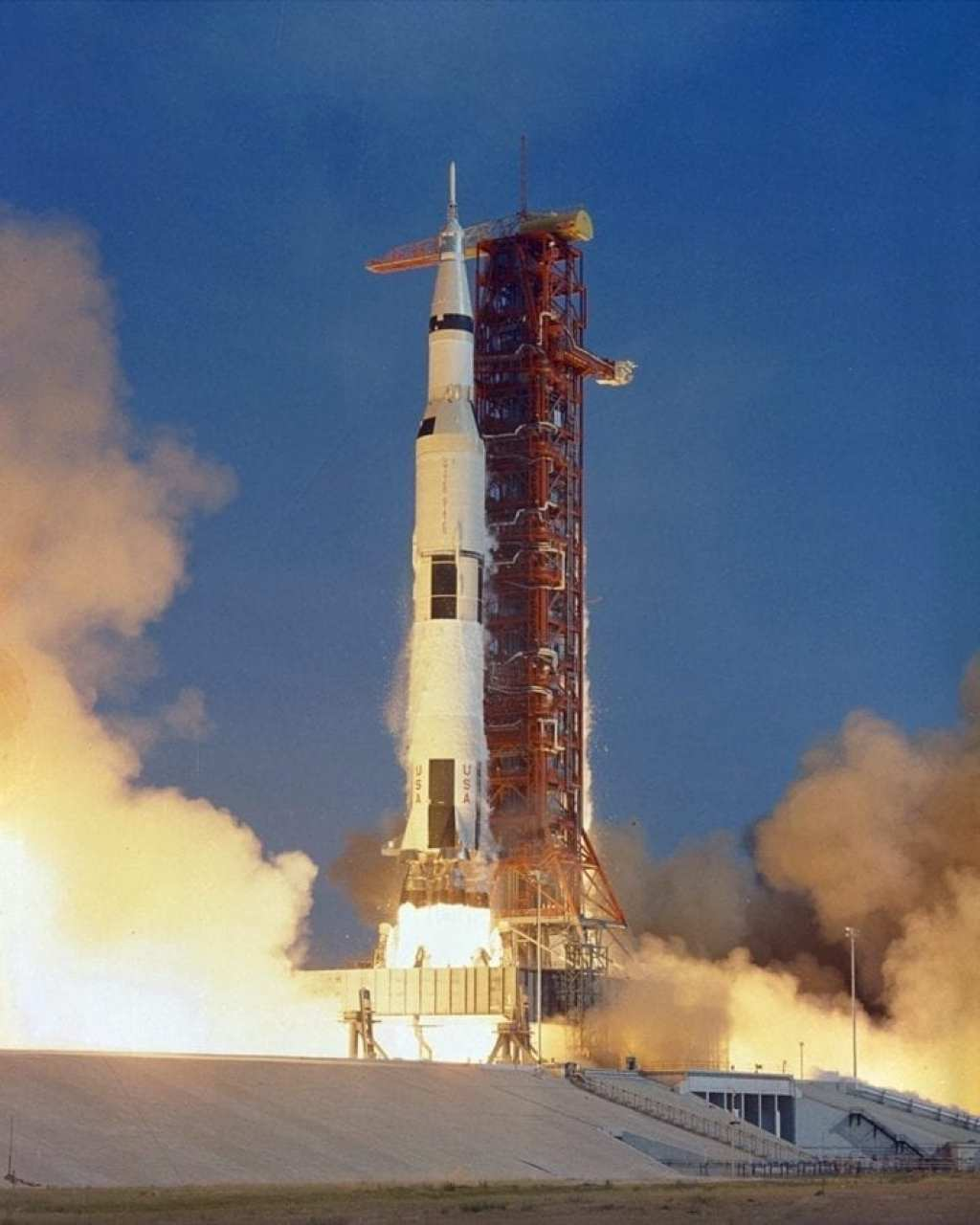 The Apollo 11 Saturn V space vehicle lifts off with astronauts Neil A. Armstrong, Michael Collins and Edwin E. Aldrin, Jr., at 9:32 a.m. EDT July 16, 1969, from Kennedy Space Center's Launch Complex 39A.
