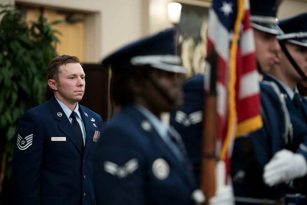 Technical Sgt. Michael Perolio, stands at attention during the playing of the National Anthem during an event in his honor, where he was presented both the Silver and Bronze Stars, at Joint Base San Antonio-Lackland July 18, 2019. (U.S. Air Force photo by Sarayuth Pinthong)