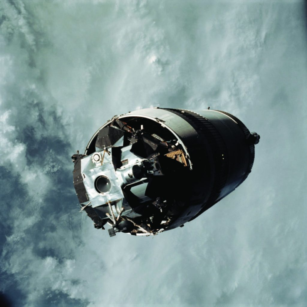 The LM Spider, still attached to the Saturn V third (S-IVB) stage, is photographed from the CSM Gumdrop on the first day of the Apollo 9 Earth orbital mission. This picture was taken following CSM/LM-S-IVB separation and prior to LM extraction from the S-IVB. The Spacecraft Lunar Module Adapter (SLA) panels have already been jettisoned. Inside the command module were astronauts James A. McDivitt, commander; David R. Scott, command module pilot; and Russell L. Schweickart, lunar module pilot. RIGHT: Designed and developed by Rocketdye under the direction of the