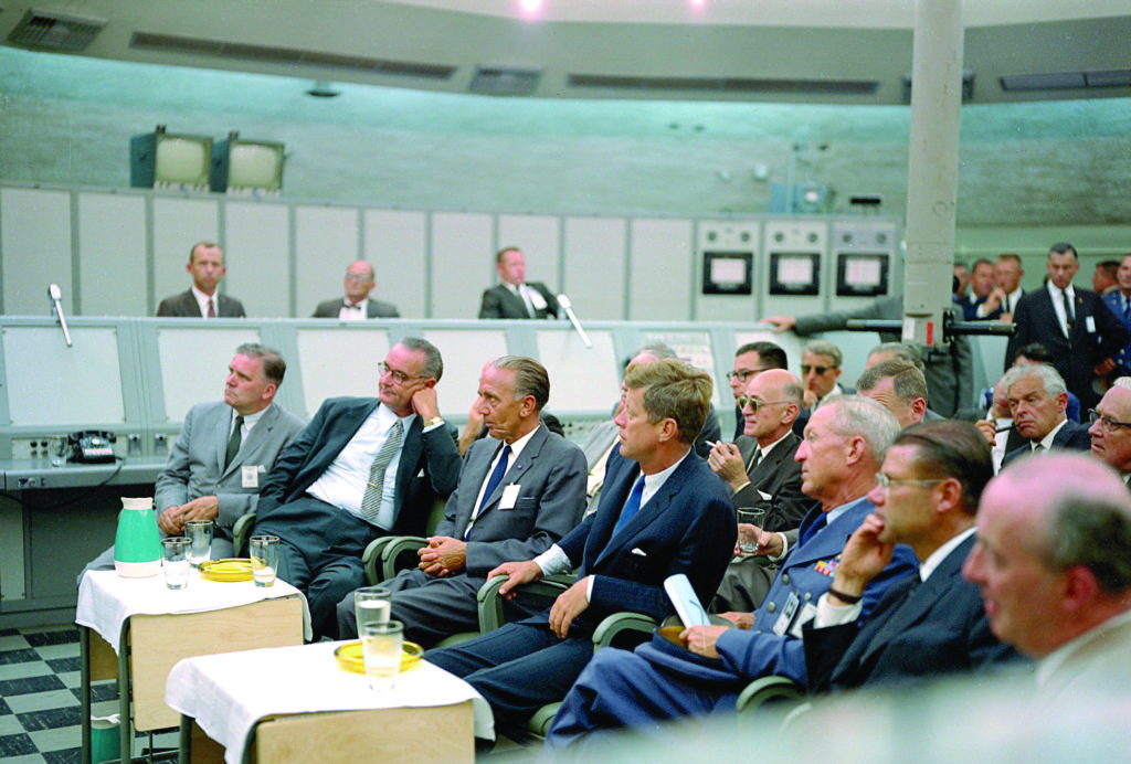 A briefing is given by Major Rocco Petrone to President John F. Kennedy during a tour of Blockhouse 34 at the Cape Canaveral Missile Test Annex.