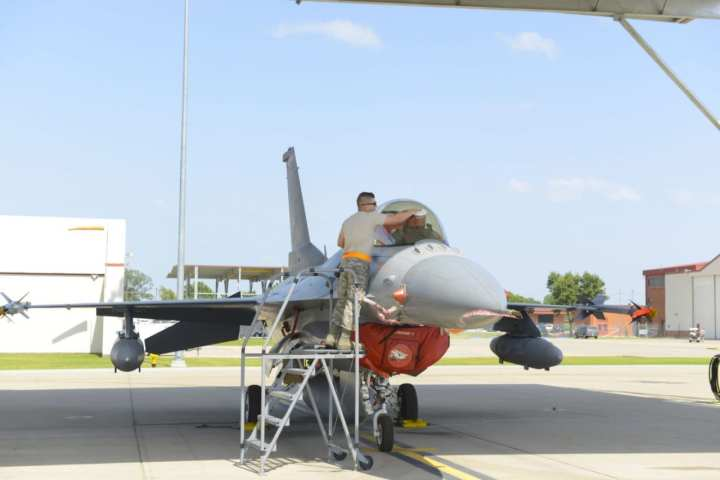 Staff Sgt. Cody Brown, 138th Maintenance Squadron, polishes the canopy of an F-16 Fighting Falcon fighter jet as part of the post-flight procedures July 13, 2016 at the 138th Fighter Wing. The wraparound canopy provides ideal light during flight and can withstand the impact of a 4-pound bird at 550 knots. (Air National Guard photo by Master Sgt. Roberta A. Thompson)