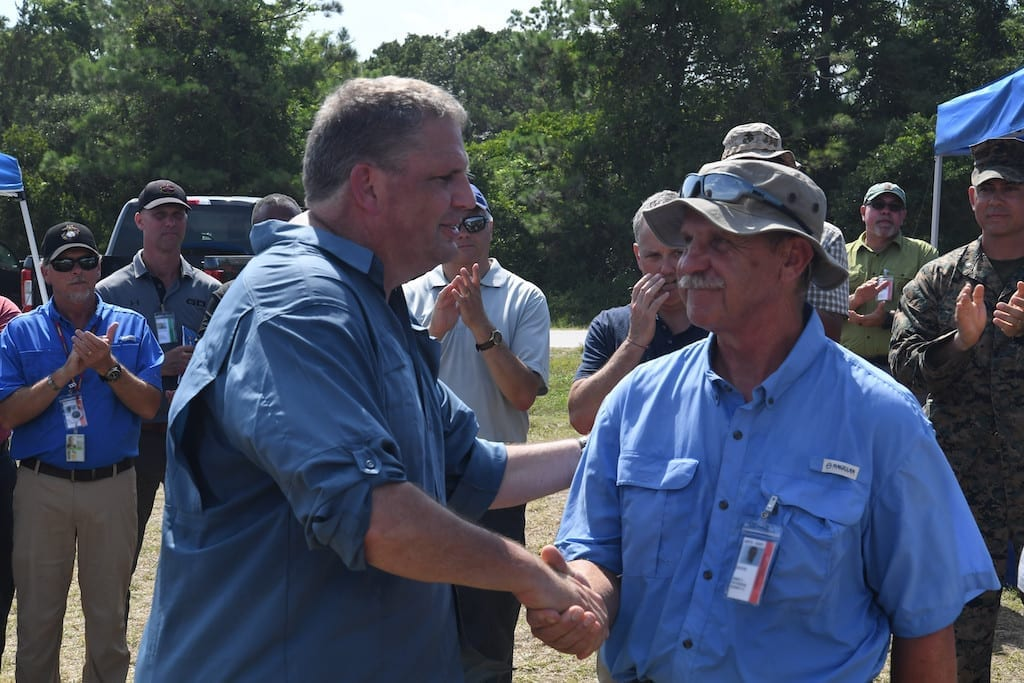 James Geurts (left), assistant secretary of the Navy for research, development and acquisition, congratulates Rod Peterson on a successful Advanced Naval Technology Exercise (ANTX) East in Camp Lejeune, N.C., on July 18, 2019. Peterson is the Marine Corps Vulnerability and Protection Program manager at Naval Surface Warfare Center, Carderock Division and was the technical lead for ANTX East. (U.S. Navy photo by Kelley Stirling/Released)