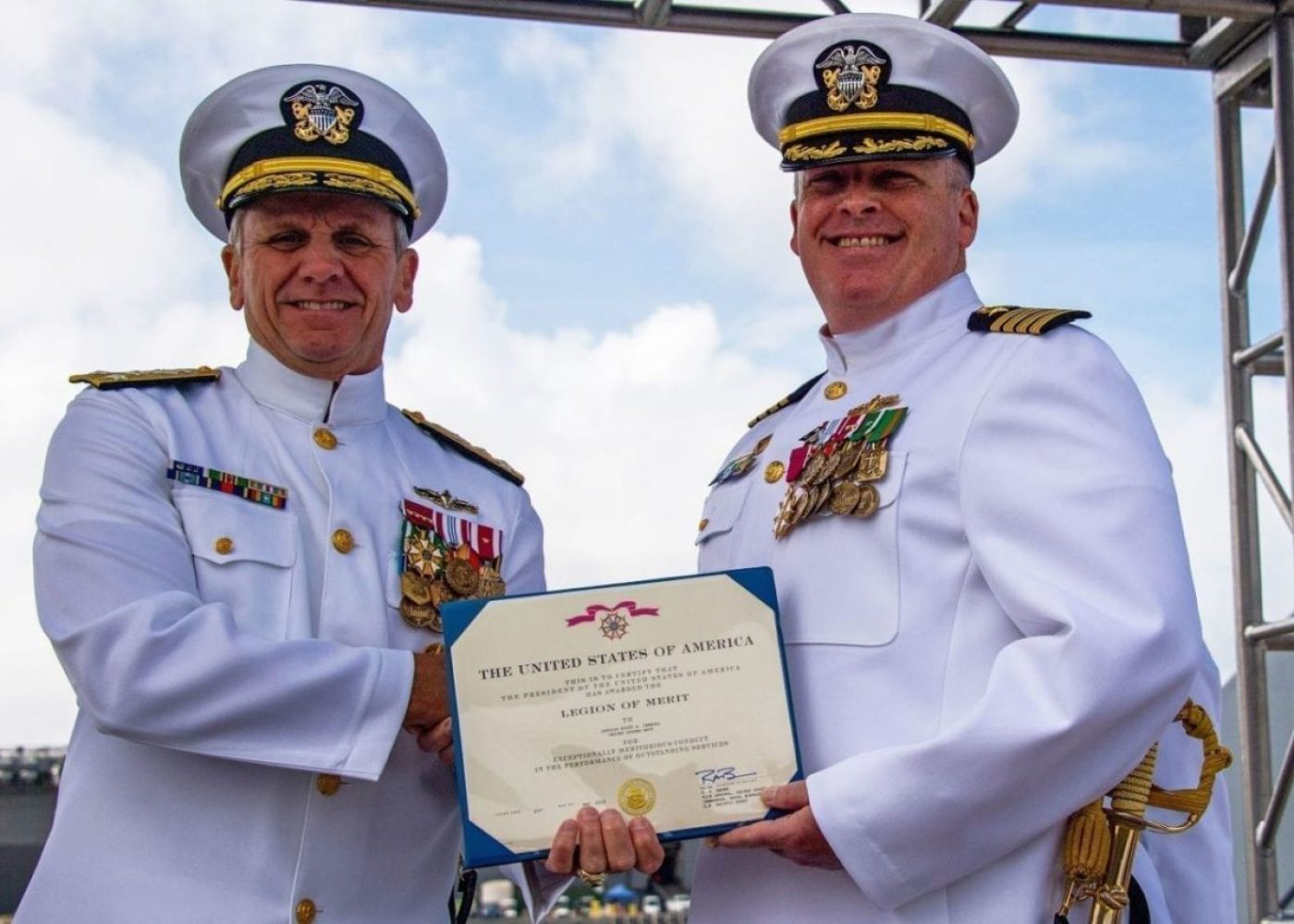 Vice Adm. Rich Brown, commander, Naval Surface Force, U.S. Pacific Fleet, presents the Legion of Merit to Capt. Scott Carroll in recognition of his leadership of Commander Zumwalt Squadron ONE during its transition into the newly established Surface Development Squadron ONE at Naval Base San Diego May 22, 2019. SURFDEVRON ONE is expected to follow the innovative legacy of Zumwalt Squadron ONE and Adm. Elmo Zumwalt to integrate unmanned surface vessels (USV) and support fleet experimentation to accelerate delivery of new warfighting concepts and capabilities to the fleet.