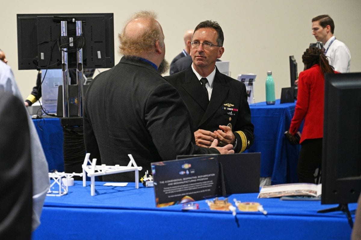Rear Adm. David Hahn visits the Office of Naval Research and Naval Research Laboratory exhibit at the Sea-Air-Space exposition.