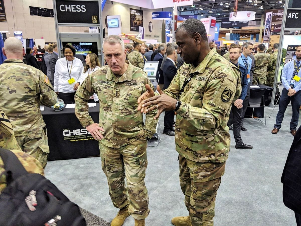 "John ""Mike"" Murray (left), commanding general of Army Futures Command, receives a brief by Maj. Gen. Cedric Wins (right), commanding general of Combat Capabilities Development Command, highlighting CCDC's innovative technological solutions on display at AUSA Global Force Symposium 2019 in Huntsville, Alabama."