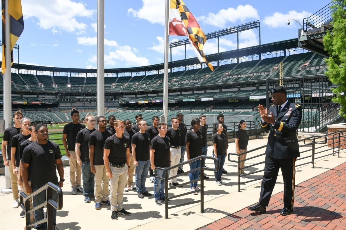 Maj. Gen. Cedric Wins, commanding general of U.S. Army Combat Capabilities Development Command, congratulates new Army recruits at a swearing-in ceremony at Orioles Park at Camden Yards in Baltimore, Maryland in June 2019.