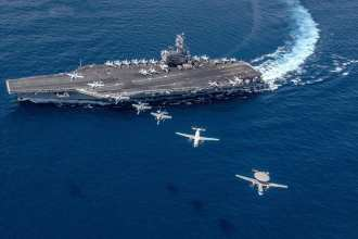 Multiple aircraft from Carrier Air Wing 5 fly in formation over the Navy's forward-deployed aircraft carrier USS Ronald Reagan. (U.S. Navy photo by Mass Communication Specialist 2nd Class Kaila V. Peters/Released)