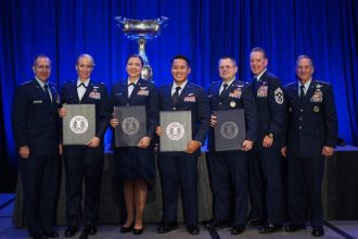 Members of the U-28A DRACO 42 crew stand with Air Force Chief of Staff Gen. David L. Goldfein, U.S. Air Force Lt. Gen. Jim Slife, commander of Air Force Special Operations Command, and U.S. Air Force Chief Master Sgt. Cory Olson, AFSOC command chief, at the Crystal Gateway Marriott in Arlington, Virginia, Nov. 13, 2019. (Courtesy photo)