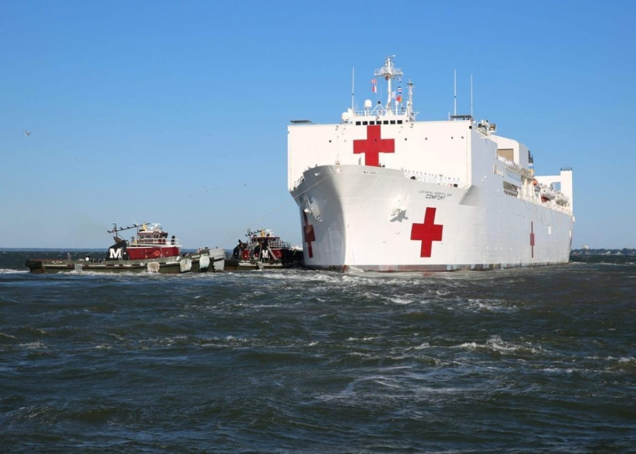 A view of the U.S. Navy Hospital Ship USNS Comfort (T-AH 20) as it gets underway from Naval Station Norfolk, June 14, 2019. Comfort got underway to begin its deployment to South America, Central America, and the Caribbean in support of humanitarian and partner-building efforts.