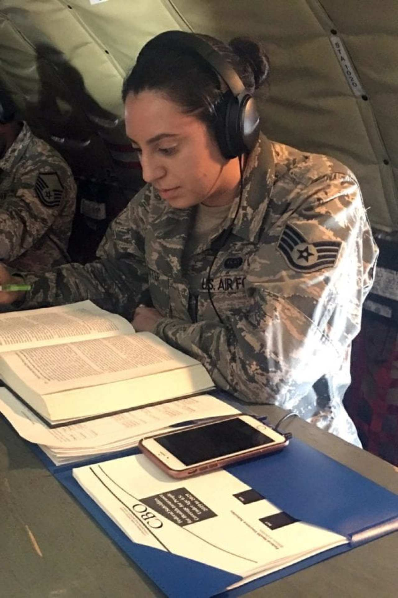 Senior Airman Jamie Foster, a member of the Michigan Air National Guard's 127th Wing and a second-year law student at the University of Michigan Law School, works on homework during a flight aboard a KC-135 Statotanker en route from Michigan to Alaska, Aug. 25, 2019. Foster is using her military educational benefits to pay for law school and then hopes to become a lawyer in the U.S. Air Force Judge Advocate General Corps. The Forever G.I. Bill expands eligibility to a wider group of service members, including National Guard members, and eliminates a pervious 15-year time limit on benefits.