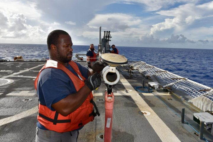 Dwight Smith, a Scan Eagle technician, prepares for the capture of a Small Unmanned Aerial System or drone aboard USCGC Stratton, in the Pacific, Oct. 31, 2019. The cutter's crew spent half of 2019 underway in support of joint operations in the Pacific. (U.S. Coast Guard photo by Chief Petty Officer Sara Muir/Released)