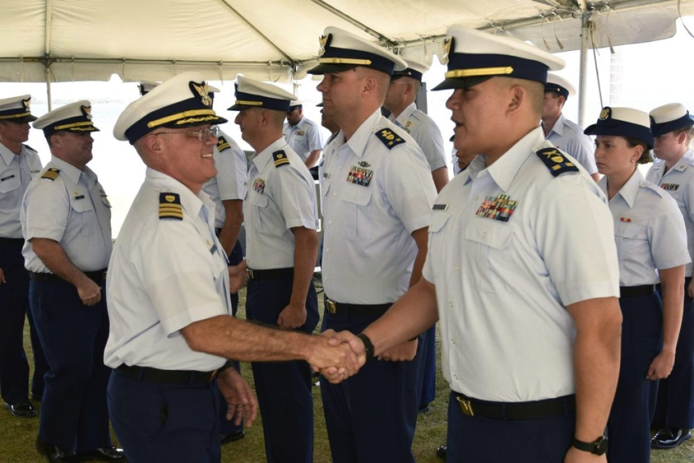 Cmdr. Javier Delgado, commanding officer of Base San Juan, inspects and greets unit personnel during the April 30, 2019 ceremony in Puerto Rico established Base San Juan as a new Coast Guard unit. Base San Juan will be providing essential mission support services to Sector San Juan, as the Sector focuses on conducting vital Coast Guard missions in the Eastern Caribbean.