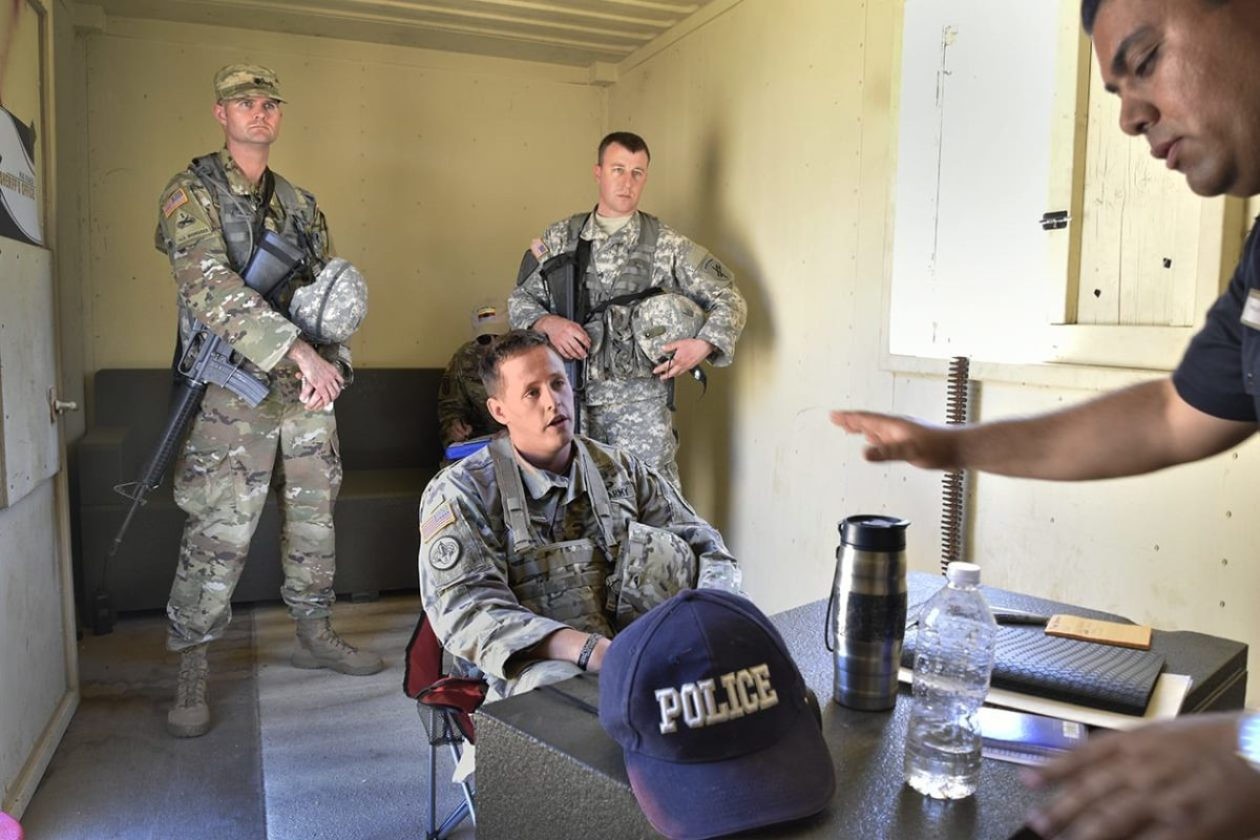 Staff Sgt. Ryan Moore and his psychological operations team visit the village's chief of police during a training scenario at Fort Hunter Liggett, California in June 2019. Their challenge was finding common ground with the belligerent lawman and persuading him to turn over a prisoner they felt was being mistreated. Fort Hunter Liggett's 80th Training Command (TASS) conducts a month-long PSYOP course for Soldiers and Marines reclassifying their military occupational specialties. (Photo by Cynthia McIntyre)