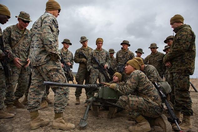 Cpl. Justus Kree, a machine gunner with 1st Marine Division, instructs Marines on the operation of a M2 .50-caliber machine gun at Marine Corps Base Camp Pendleton, California, Nov. 20, 2019. On Jan. 16, Marine Corps Systems Command awarded a contract to MAC LLC for approximately $10 million for polymer ammunition to be used in the M2 Machine Gun. (U.S. Marine Corps photo by Cpl. Cutler Brice)