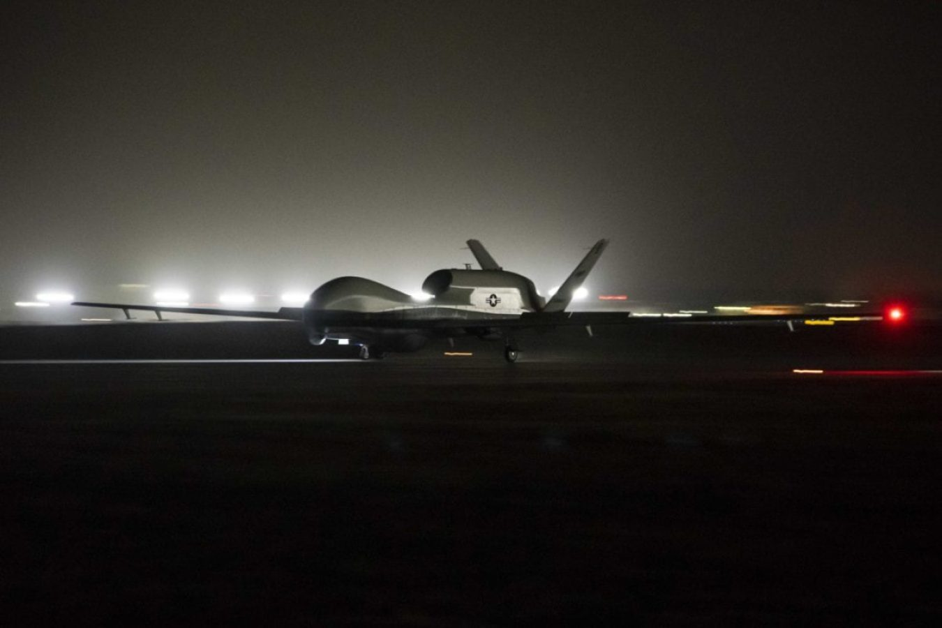 An MQ-4C Triton unmanned aircraft system (UAS) idles on a runway at Andersen Air Force Base after arriving for a deployment as part of an early operational capability (EOC) test to further develop the concept of operations and fleet learning associated with operating a high-altitude, long-endurance system in the maritime domain. (U.S. Navy photo by Mass Communication Specialist 3rd Class MacAdam Kane Weissman/Released)