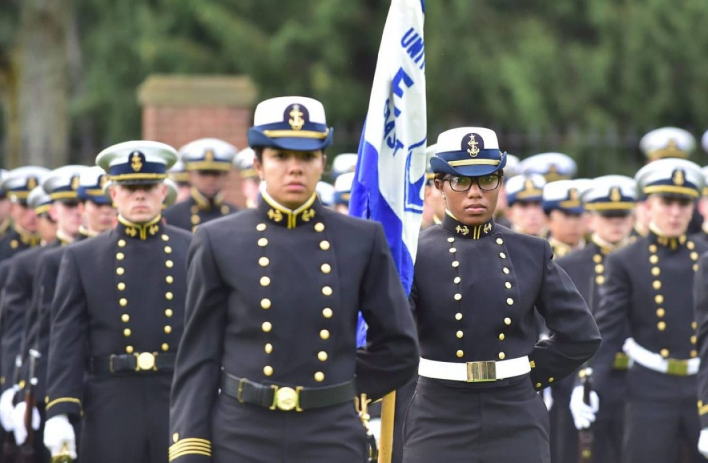 Coast Guard Academy Cadet Kayla Hughely holds the Echo Company flag during the Corps of Cadets Regimental Review, Sept. 22, 2018. Approximately 40 percent of the Coast Guard Academy Cadets are women, the highest percentage of any service.