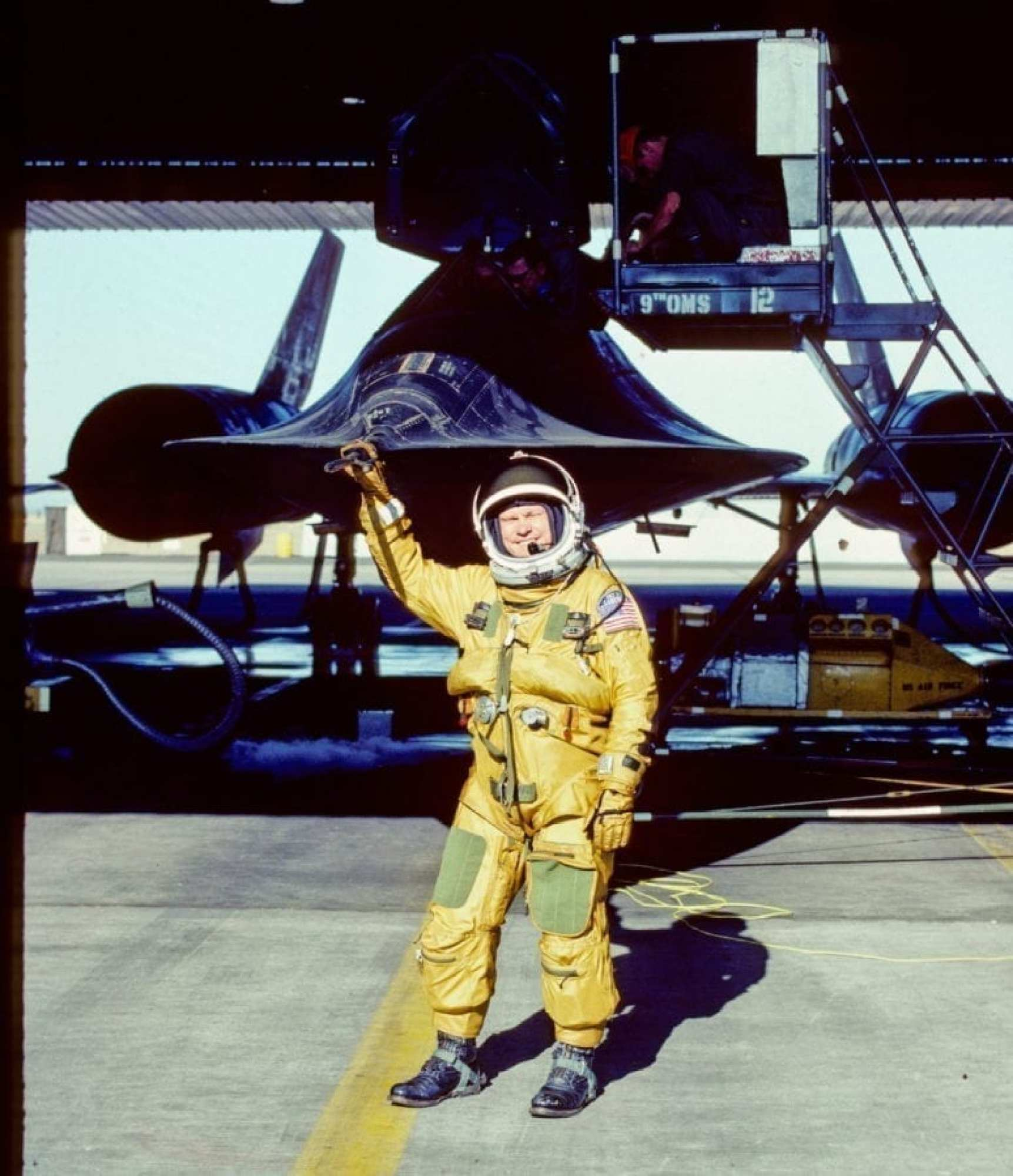 """Col. Adelbert """"Buz"""" Carpenter stands at the nose of the SR-71 he flew during his active duty career. Now retired, Carpenter gave a presentation on the venerable aircraft and its mission during the Cold War. (courtesy photo)"""