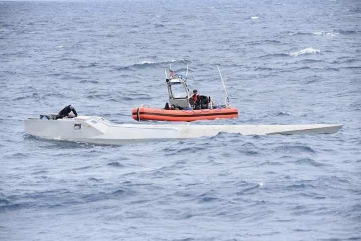 Coast Guard Cutter Thetis (WMEC 910) crewmembers inspect a low-profile semi-submersible in international waters of the Eastern Pacific Ocean Nov. 16, 2019. Coast Guard crews seized nearly 20,000 pounds of cocaine worth an estimated $338 million, through eight separate suspected drug smuggling interdictions and disruptions off the coasts of Mexico, Central and South America by four Coast Guard cutters between November 2019 and January 2020. (U.S. Coast Guard photo).