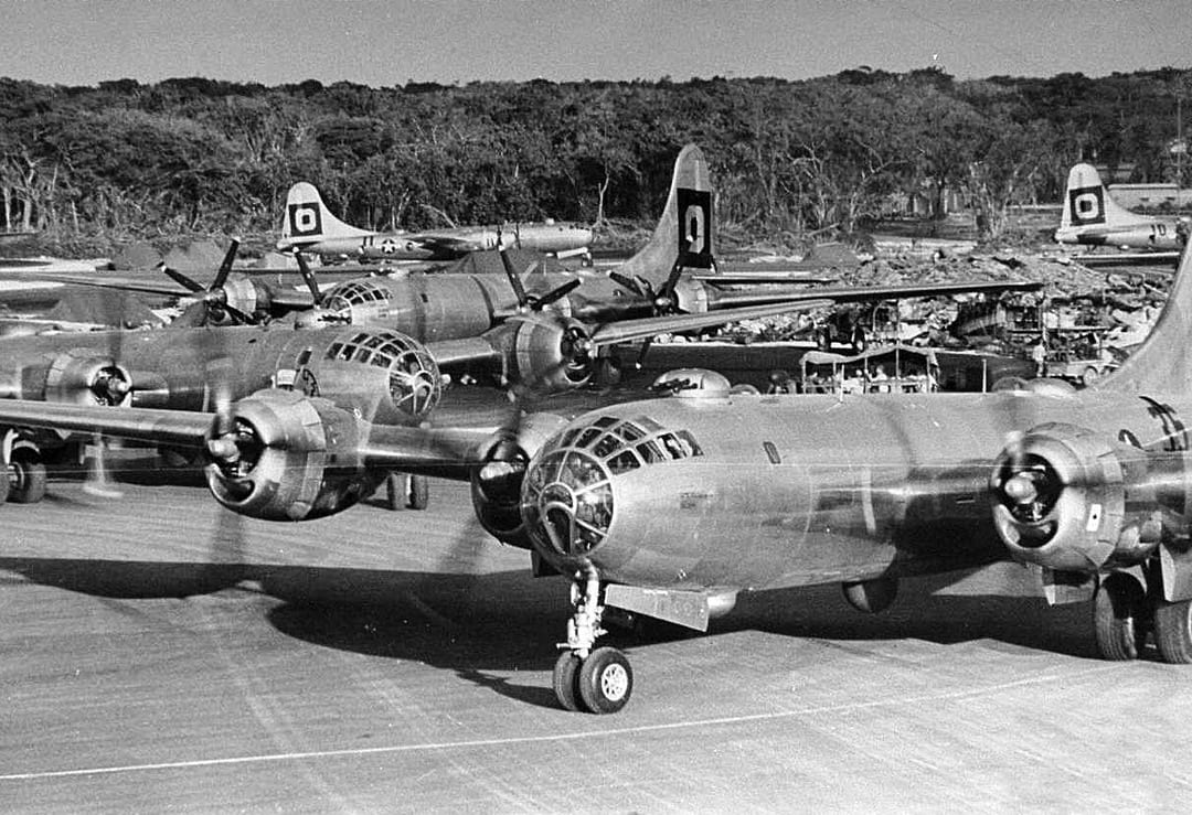 29th Bombardment Group B-29s at North Field, Tinian, 1945. Iwo Jima constituted a danger to B-29 raids on the Home Islands, first because Japanese fighter aircraft were based there, and second, even when raids navigated courses to stay out of range of the island's aircraft, radar on Iwo Jima could warn defenses that raids were on their way. NATIONAL ARCHIVES PHOTO