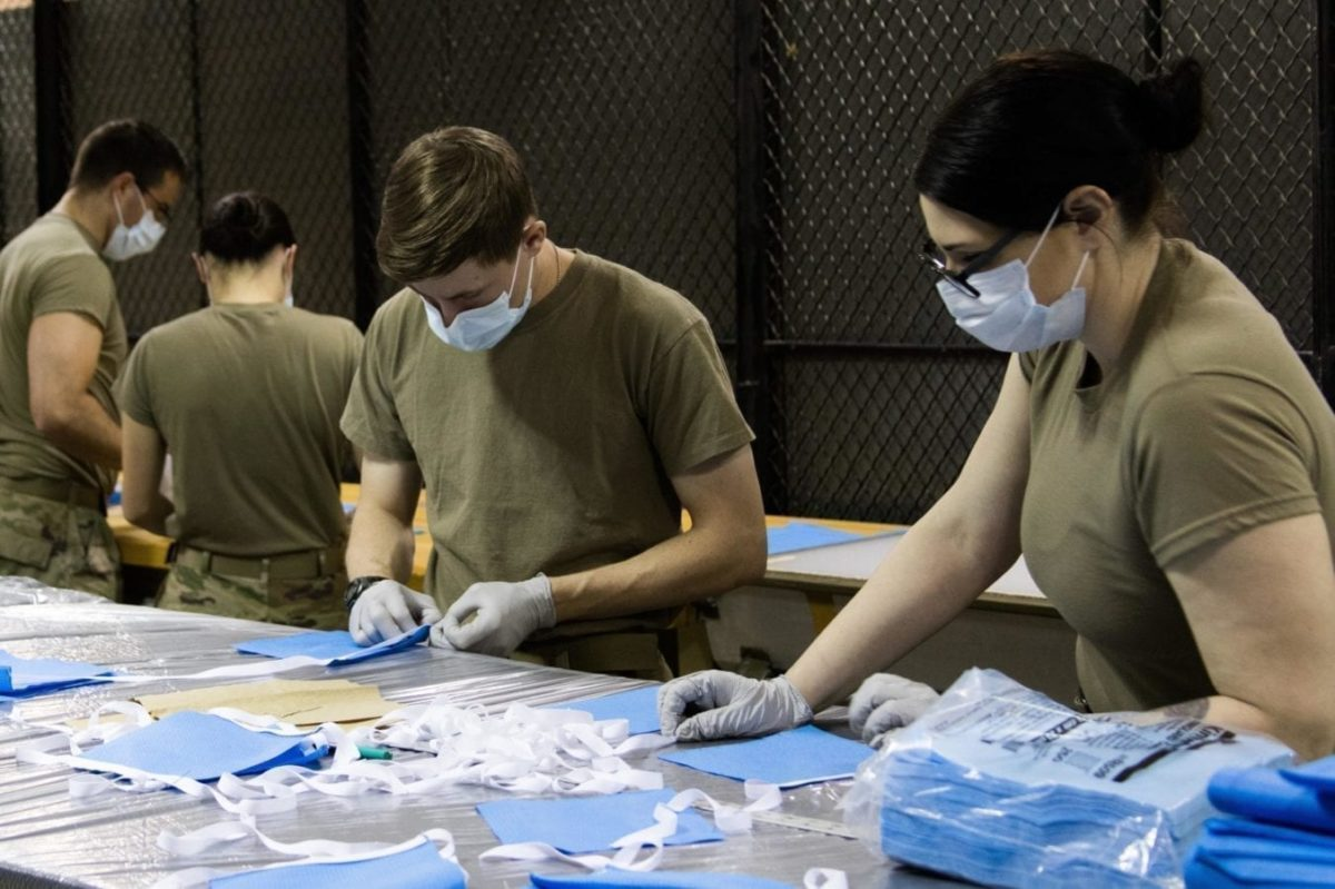 Parachute riggers with the 1st Special Forces Group's Group Support Battalion prepare surgical masks for medical patients at Joint Base Lewis-McChord, Wash., March 31, 2020.