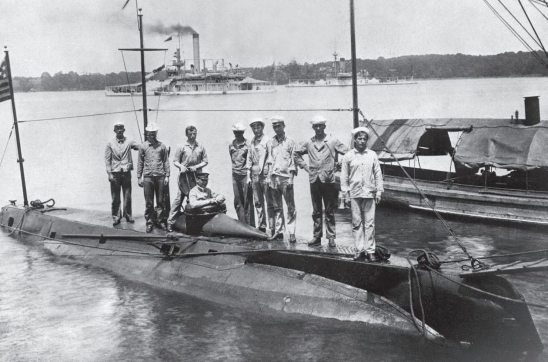 USS Holland (SS-1), the U.S. Navy's first modern submarine, was launched in May 1897 and commissioned in October 1900. She featured a conning tower, ballast and trim tanks, and a reloadable torpedo tube, along with a gasoline engine for running on the surface and an electric motor for submerged operation, powering a single screw. John P. Holland's company was purchased by the company that supplied his batteries, establishing a lineage leading to today's General Dynamics Electric Boat.