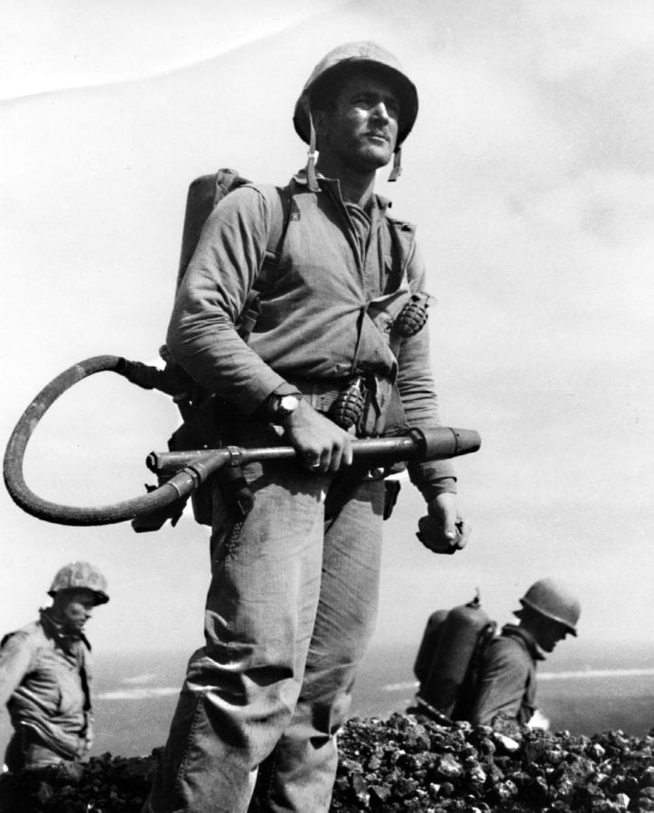 Cpl. Charles W. Lindberg on Mt. Suribachi, looking for cave entrances on the crater's rim. U.S. MARINE CORPS PHOTO BY LOU LOWERY