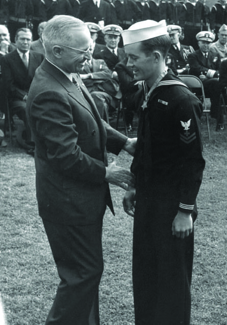 Pharmacist's Mate 2nd Class George E. Wahlen, USN, receives his Medal of Honor from President Harry S Truman. NATIONAL ARCHIVES