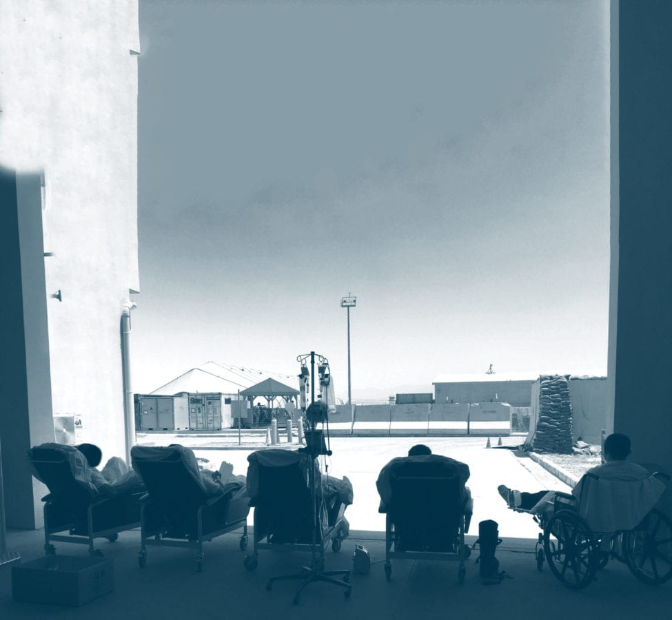 Five patients from Craig Joint Theater Hospital in Bagram, Afghanistan sit outside the hospital to get some fresh air. Courtesy image