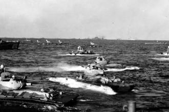 LVT(A)-4s head for the Iwo Jima beach.