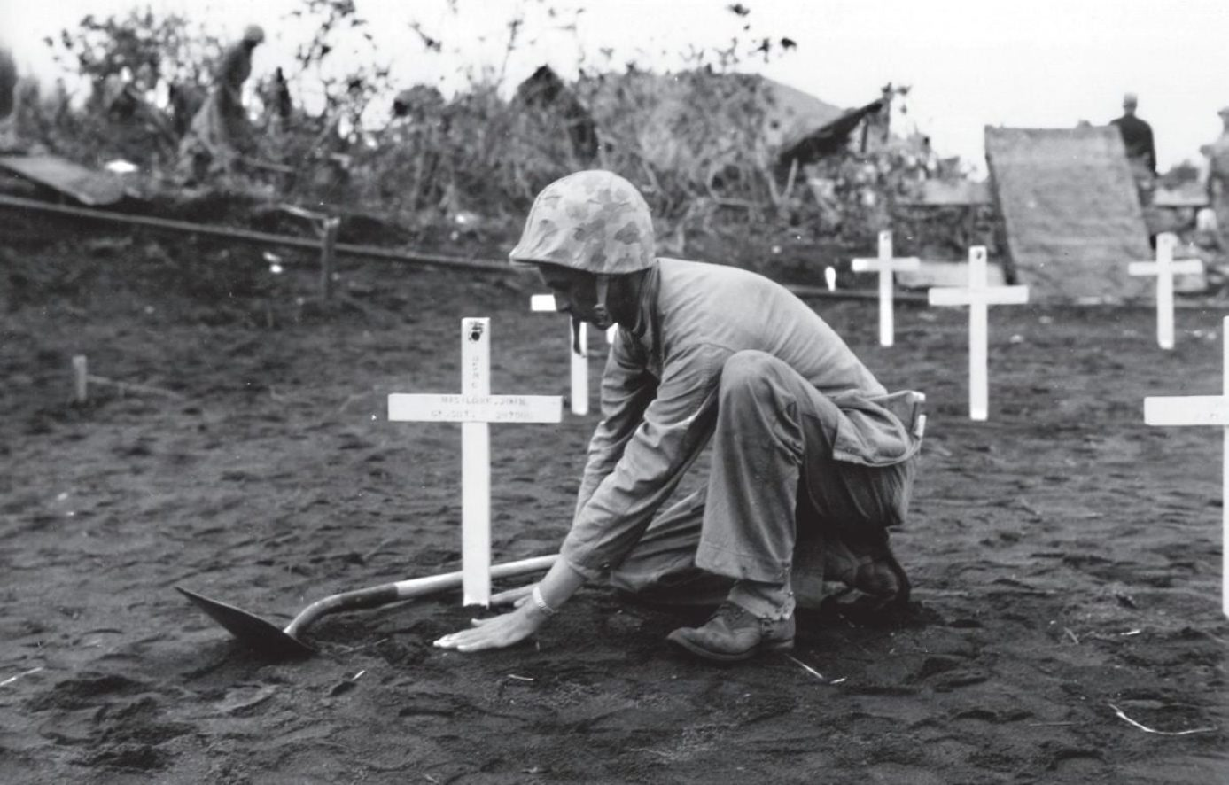 Iwo Jima Marine Tends to Grave